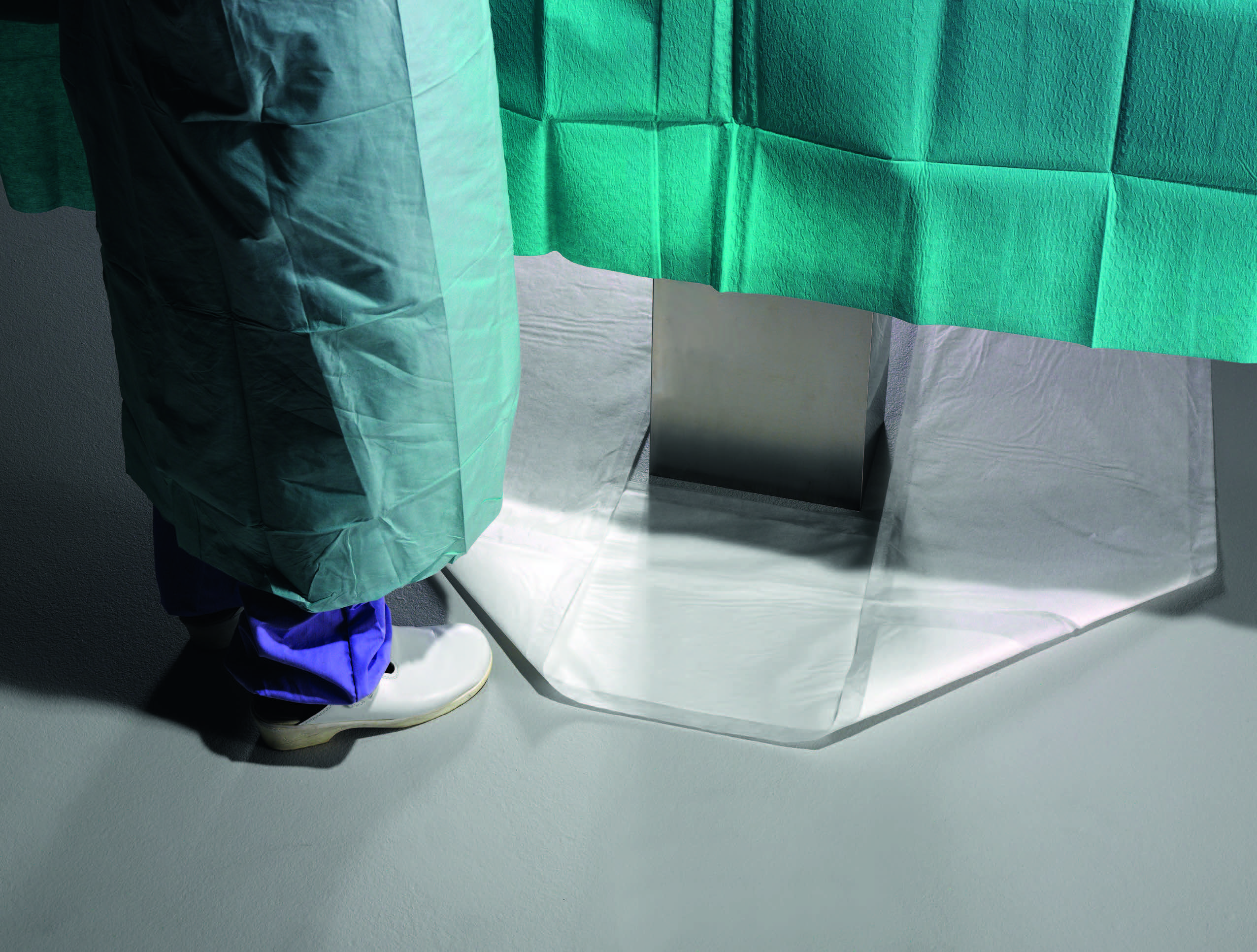 Action Products Offers Table-length Fluid Management Mat